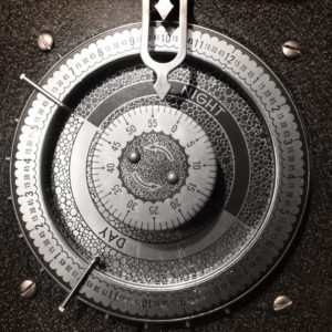 The cover image of the self titled album by This Definite Sky. It is a closeup view of a clock face in black and white. The clock face has the resemblance of a timer.